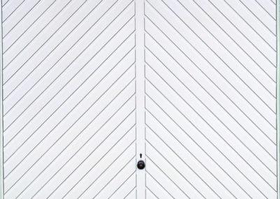 White Diagonal Panel Up and Over Garage Door